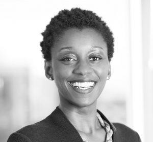 Black & white headshot of Adjoa smiling